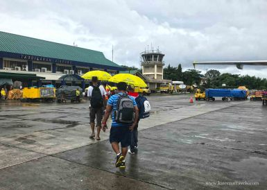 Yes Cebu Pacific hands umbrella to the passengers